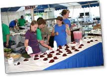 Volunteers prepare Cherry Pies for sale at Cherry Festival (circa 2009)